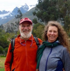 Lynn Iser and Rabbi Mordechai Liebling standing in front of snowy mountains